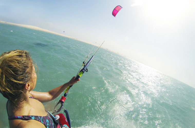 Miriam, the blogger of wake up stoked, kitesurfing on the water.