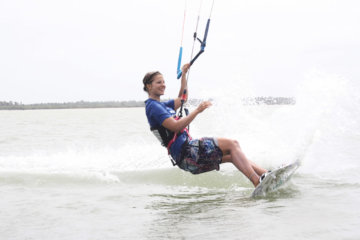 Me doing a slide turn, smiling – proof enough that kitesurfing makes you happy