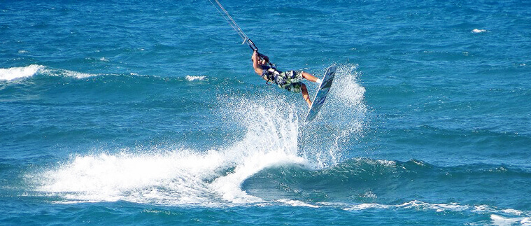 Me doing a backroll over a wave in Cabarete, Dominican Republik