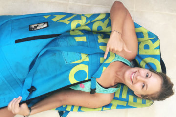 Me inside a kitesurf bag smiling
