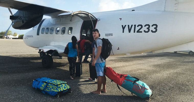 In front of the small propeller airplane on the airport