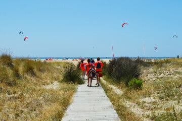 Teens walking towards the kite beach in Tarifa