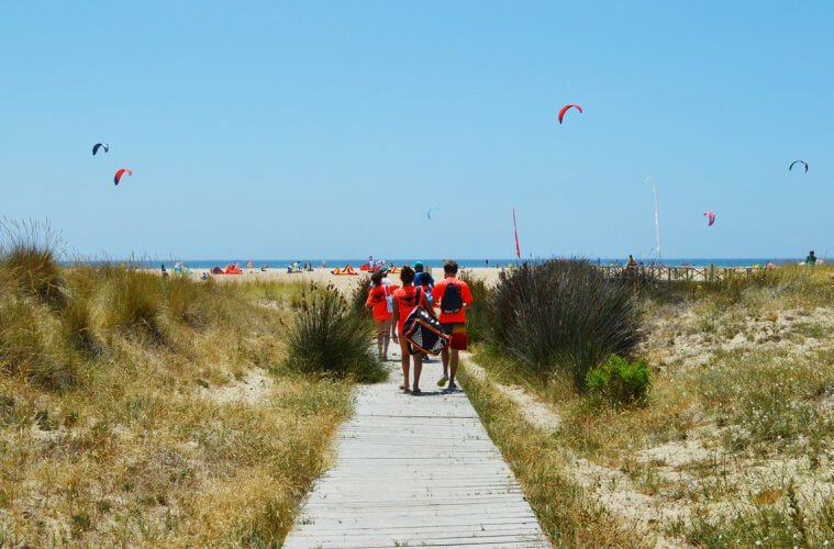 Teens walking towards the kite beach in Tarifa