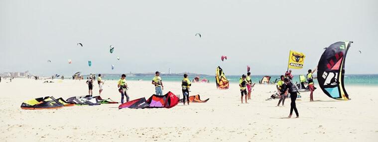 Teens learning kitesurfing in Tarifa