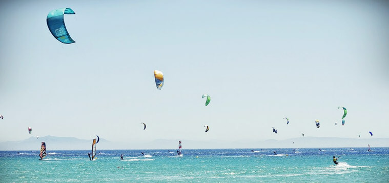 Kitesurfers on the water in Tarifa