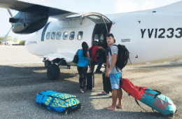 Waiting in front of the small Venezuelan propeller airpline to put our kitesurf bags in