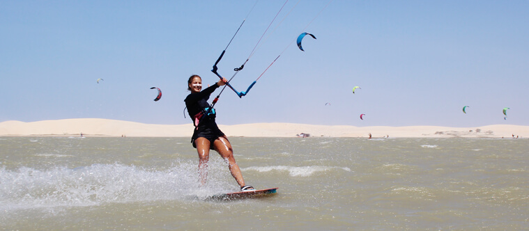 Having that big smile on your face comes naturally once you learnt how to kitesurf!