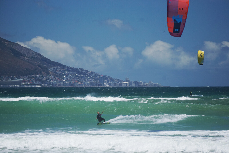 Kitesurf girl kiting in waves in Cape Town